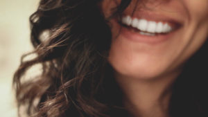 A woman's smile image for Linda C. Salvin's post on happiness
